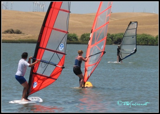 Three new windsurfers enjoying a light-wind day