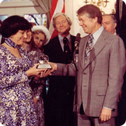 Myrra Lee, of Helix High School, accepting the 1977 National Teacher of the Year award from President Jimmy Carter.