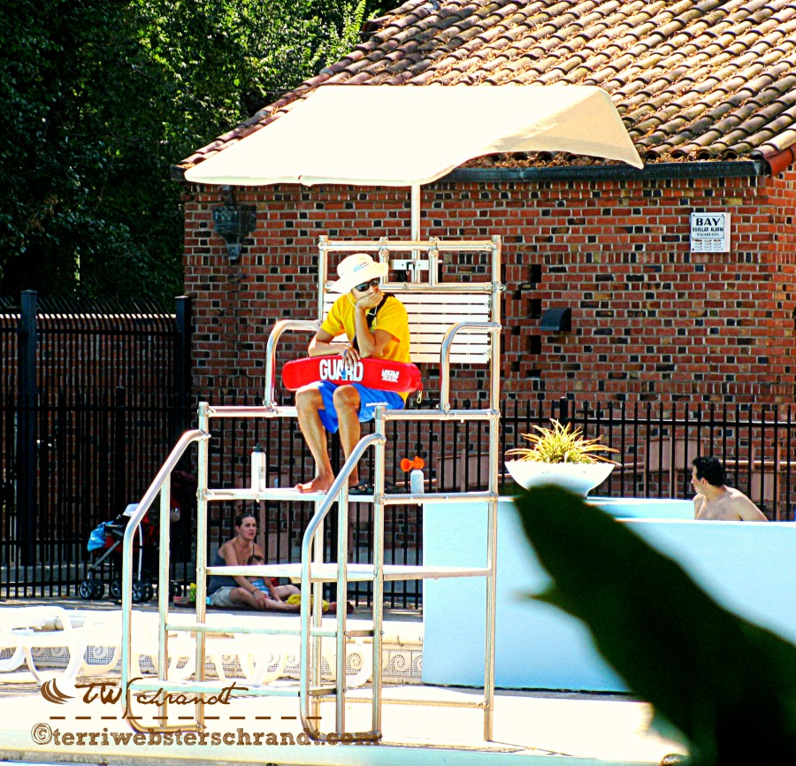 What IS that? A lifeguard's focus is drawn away from the pool.
