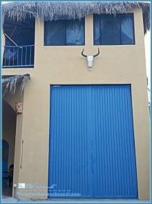 Large, blue garage door graces this fabulous retirement villa in Baja.