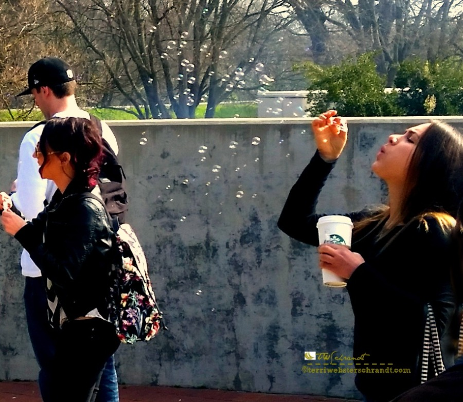 College students blow bubbles as an expression of spontaneous play in their Leisure Lifestyle development course.