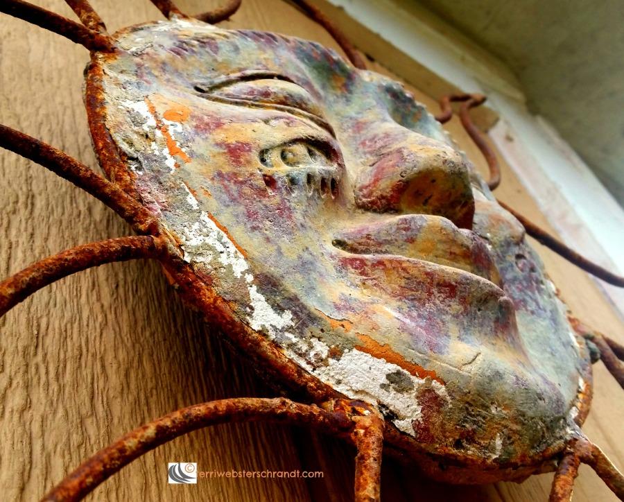 Metal Aztec sun showing a little rust