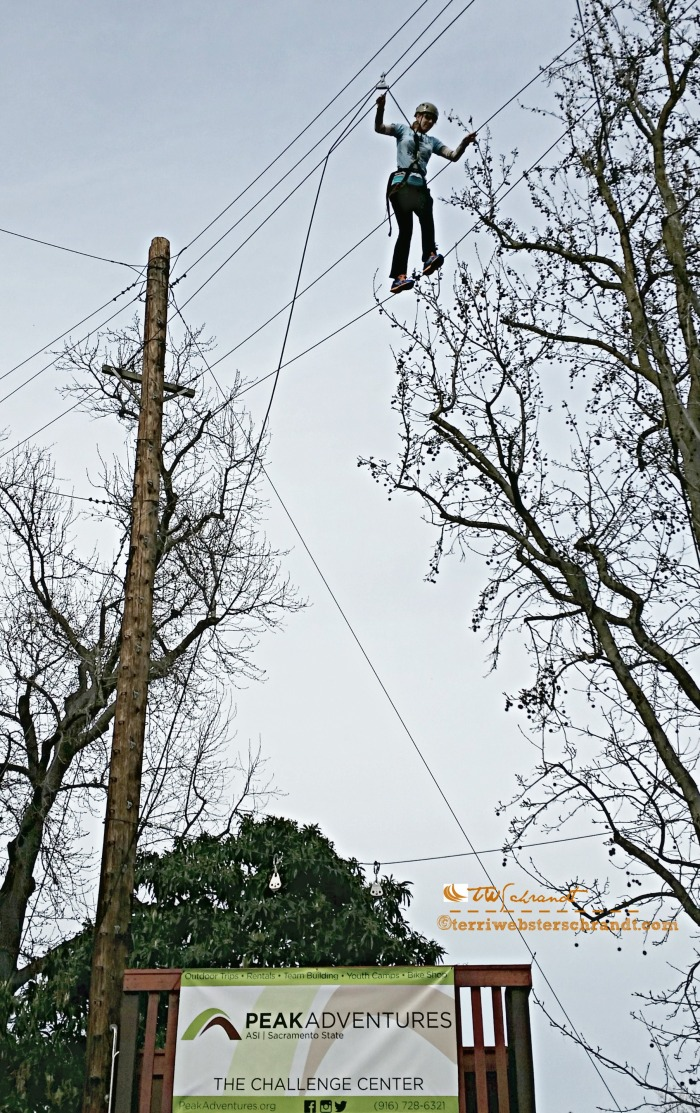 Student crosses the highwire at the Peak Adventures Challenge Course