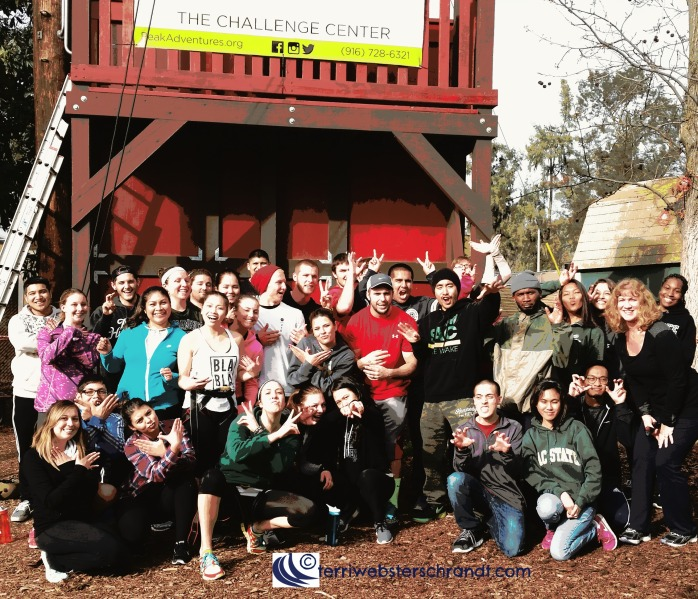Happy students pose for a group photo after a day on the challenge course