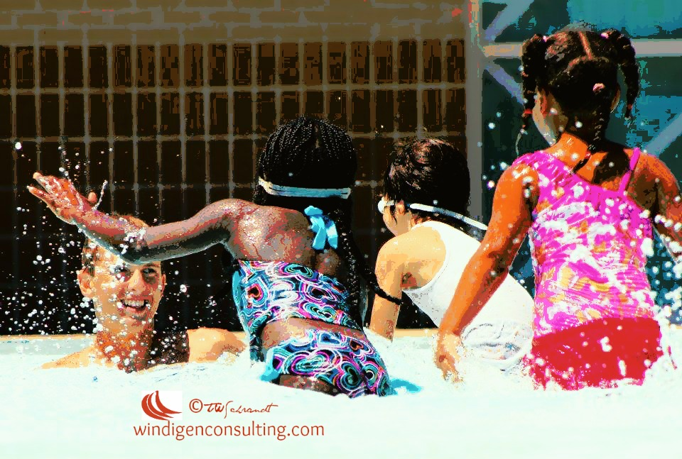 Young children get swimming lessons and learn water safety skills.