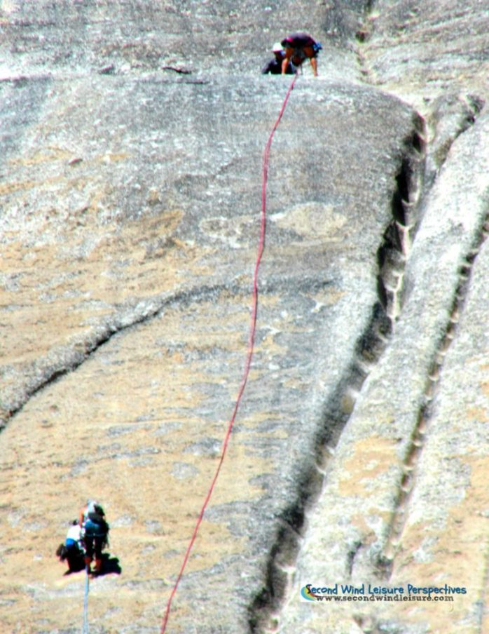 Climbers face a narrow path up the face of Lembert Dome