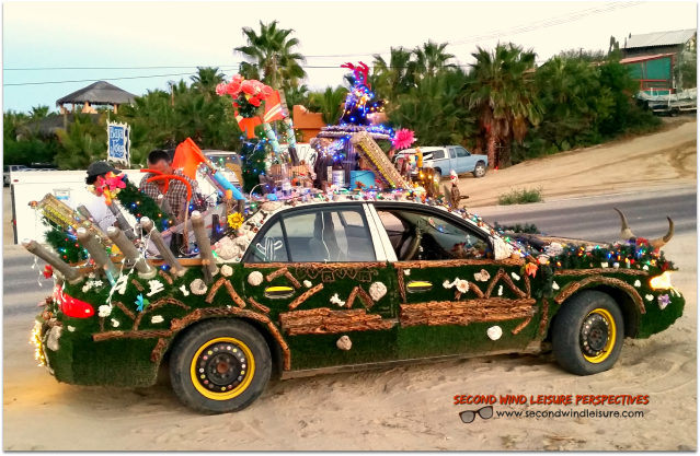 Highly decorated chaotic car drives through Baja streets