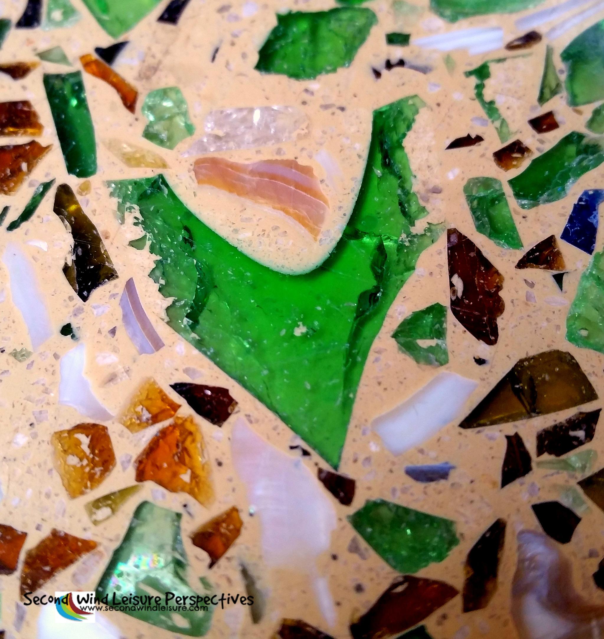 The green bits in the terrazzo floor are crushed, recycled Heineken beer bottles.