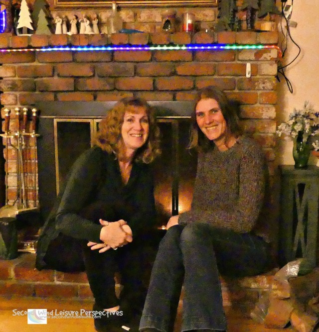 Terri and Liesbet enjoy a warm fire