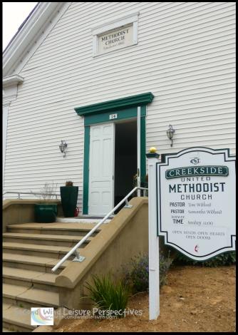 Green-framed door of this quaint, steepled church in Sutter Creek California