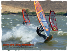 Trio of Sailors Windsurfing