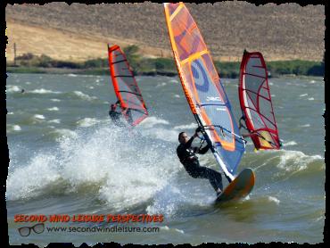 Trio of Sailors Windsurfing