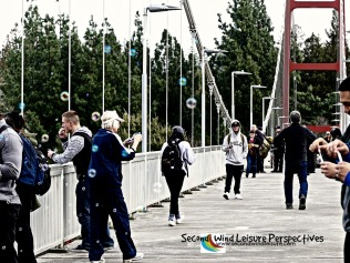Bubble-blowing session in full swing as pedestrians cross the bridge
