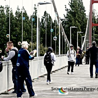 Bubble-blowing session in full swing as pedestrians cross the bridge