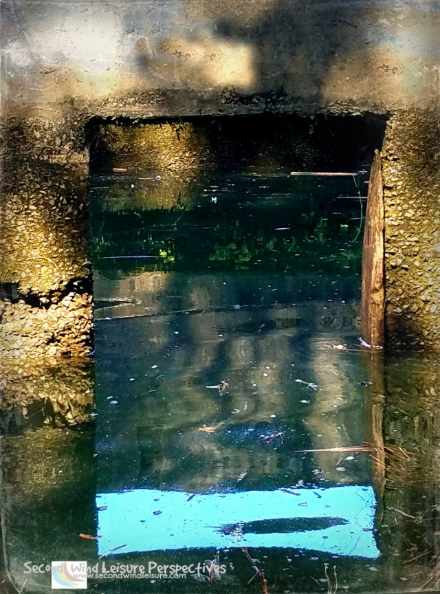 Old pumphouse window partially submerged plays trick on the eyes