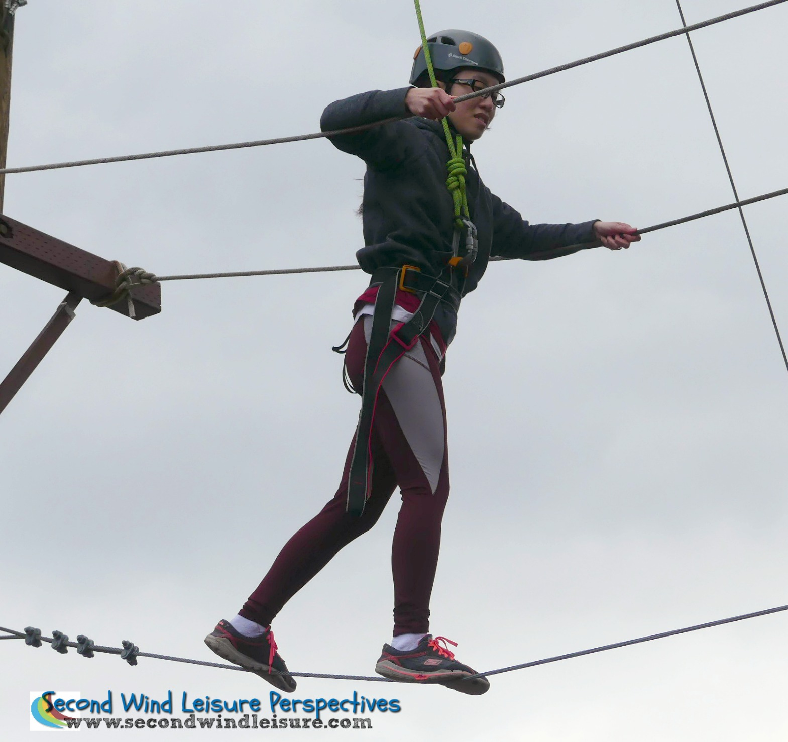 Sac State student deftly walks the high ropes course at the Challenge Center.