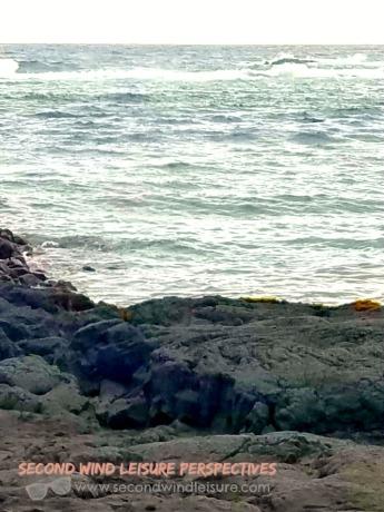 ocean erodes lava rock into black sand