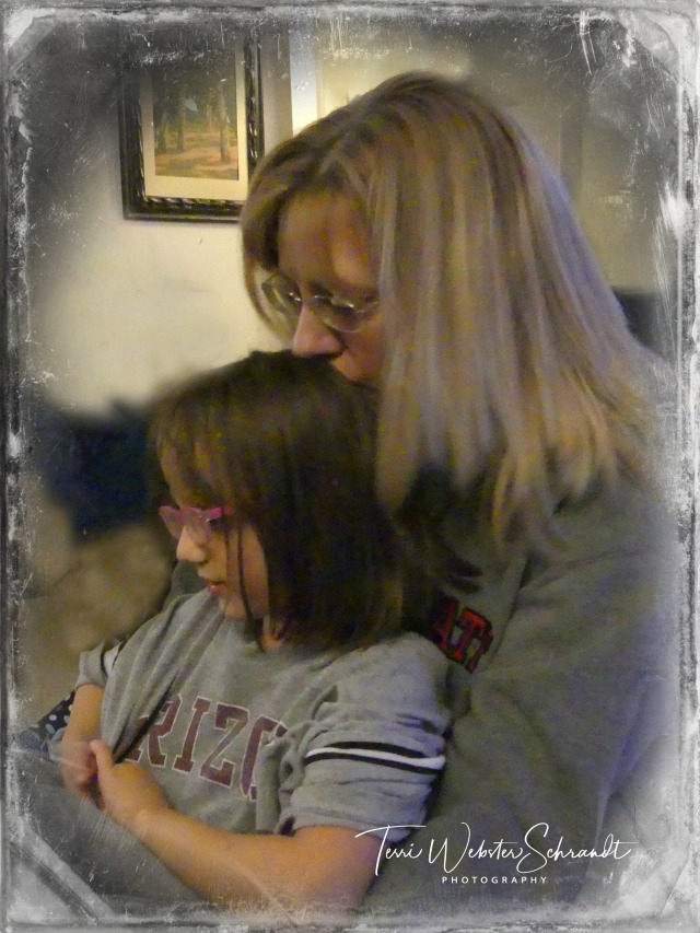 A young mother's embrace