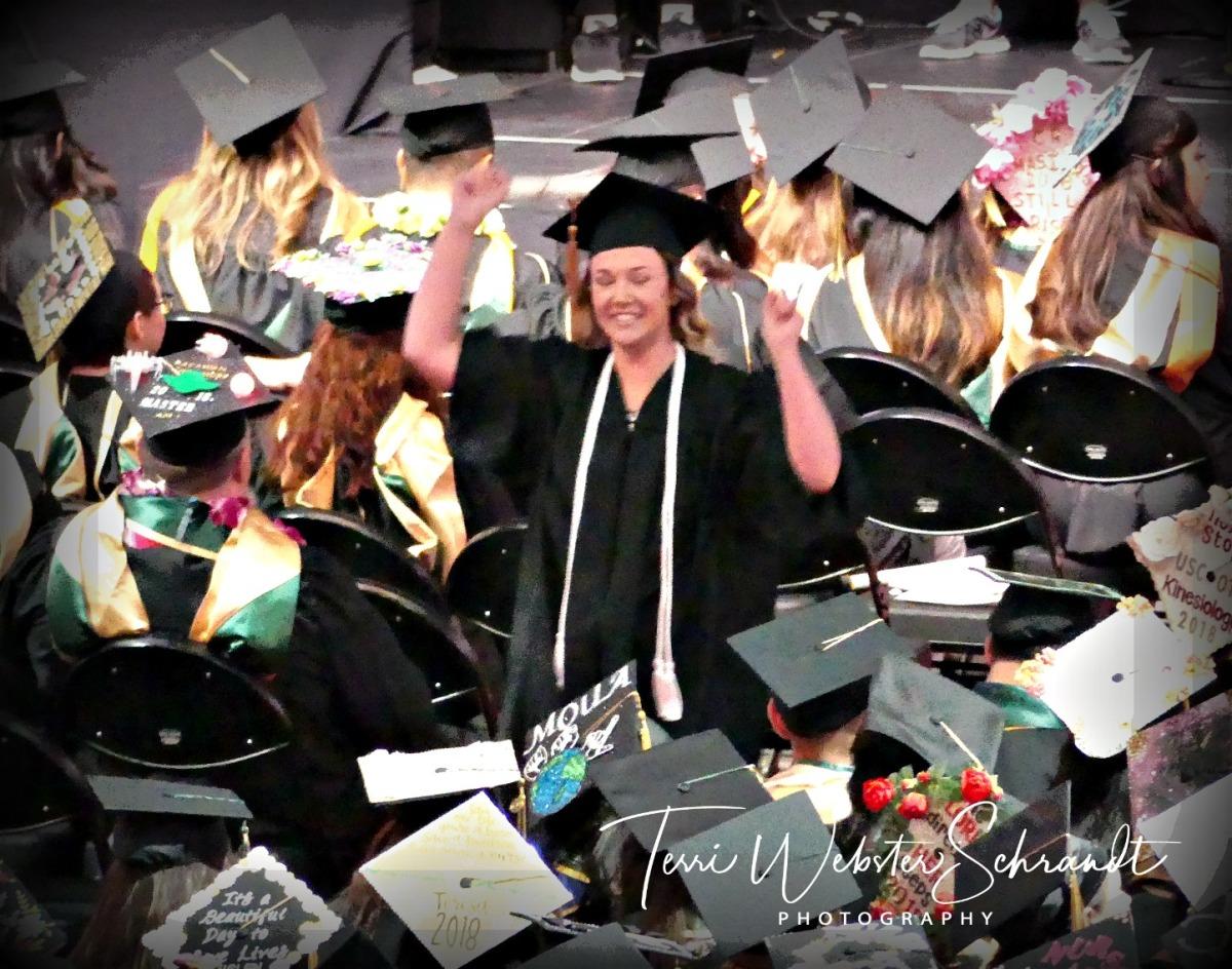 Jubilant student graduates from University