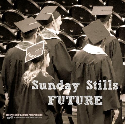 College graduates walk at commencement