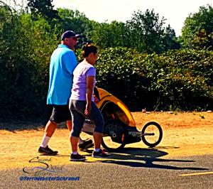 man and woman pushing stroller