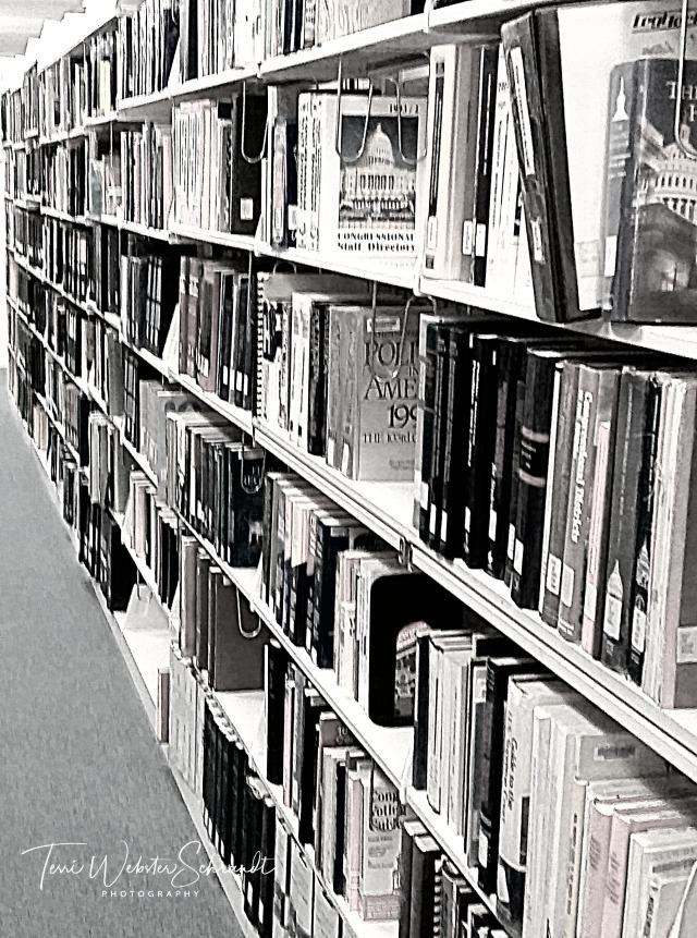 Library books on university shelves