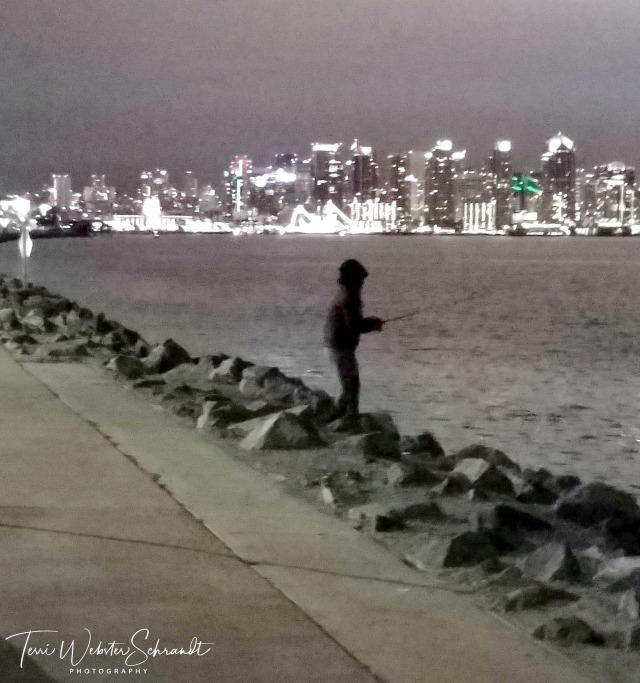 Fisherman on edge of jetty