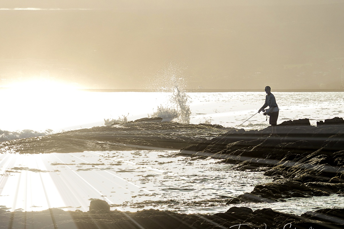 Sun sets on Hilo Bay fisherman