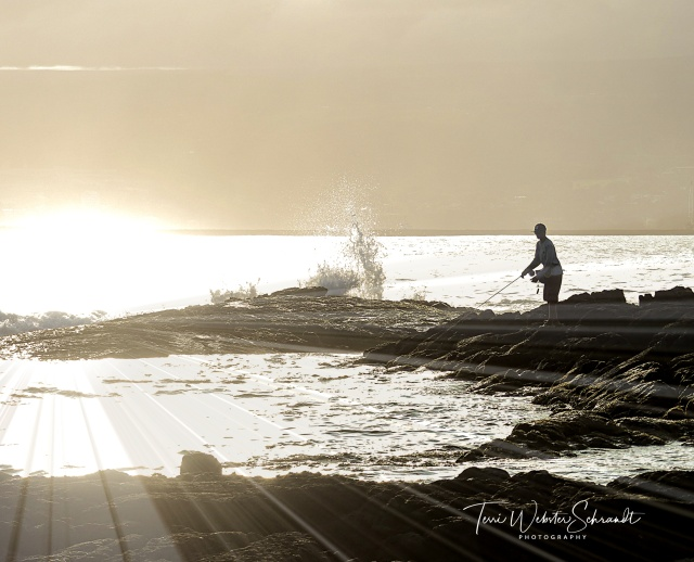 Sun sets on Hilo Bay fisherman