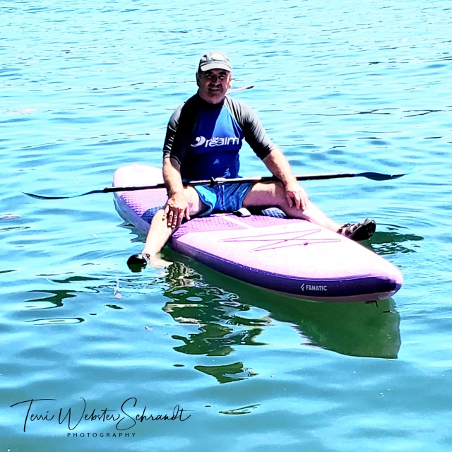 Sitting on a SUP