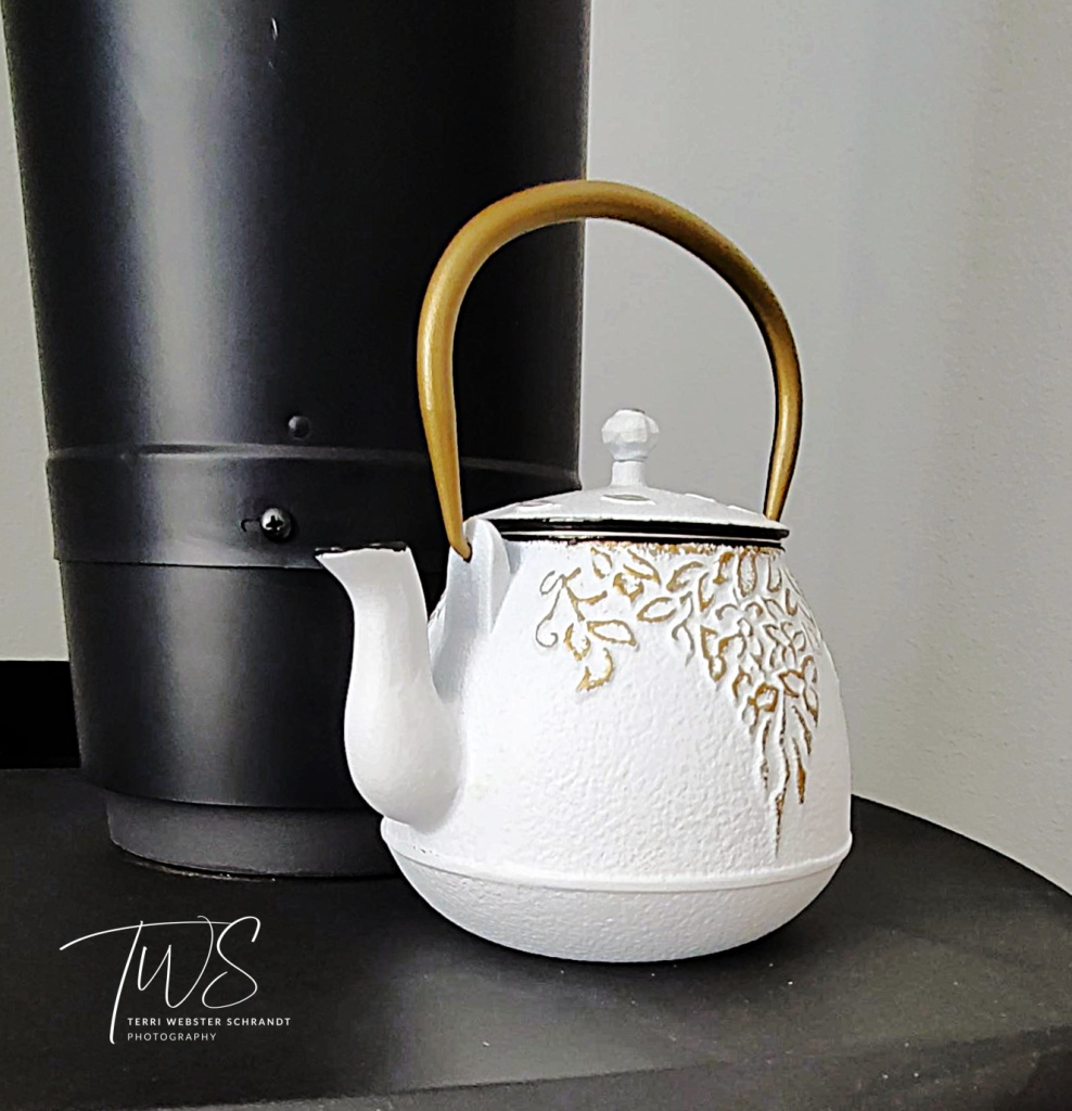 White Teapot on black stove
