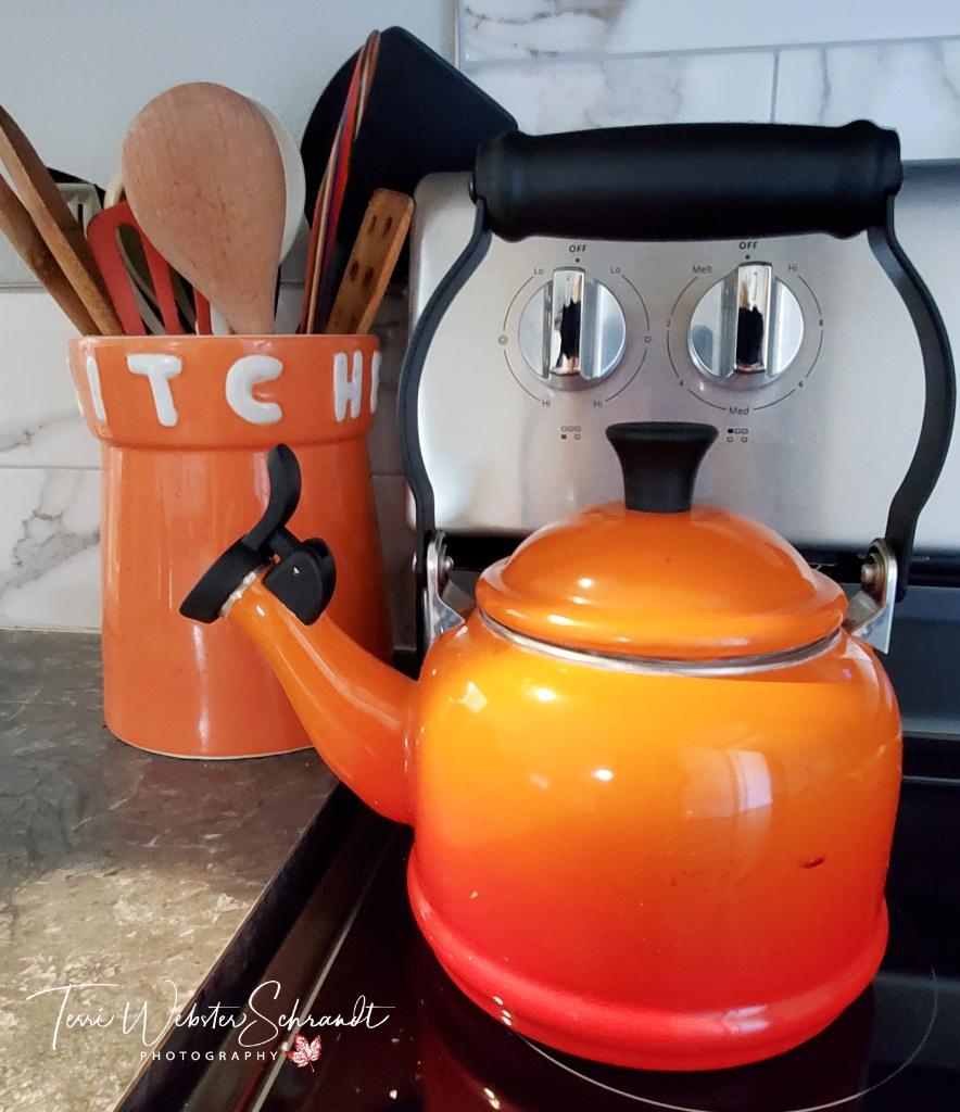 Smiling orange teapot